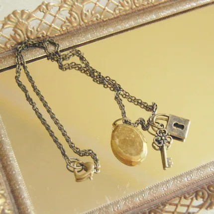 Under Lock  and Key...a locket and charm necklace