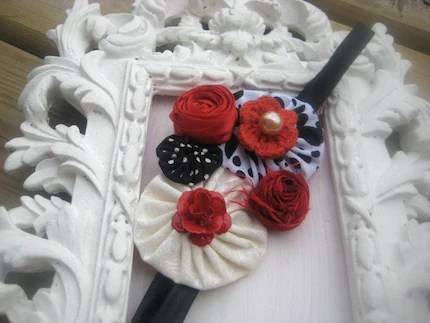 A WALK IN THE STREET OF PARIS RED WHITE AND BLACK ROSETTE YO YOS VINTAGE BUTTONS CABOCHONS SILK ROSETTES AND PEARLS