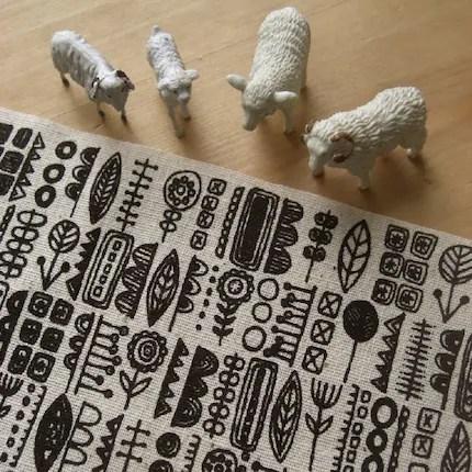 totem - hand screenprinted fabric in coal black on oatmeal