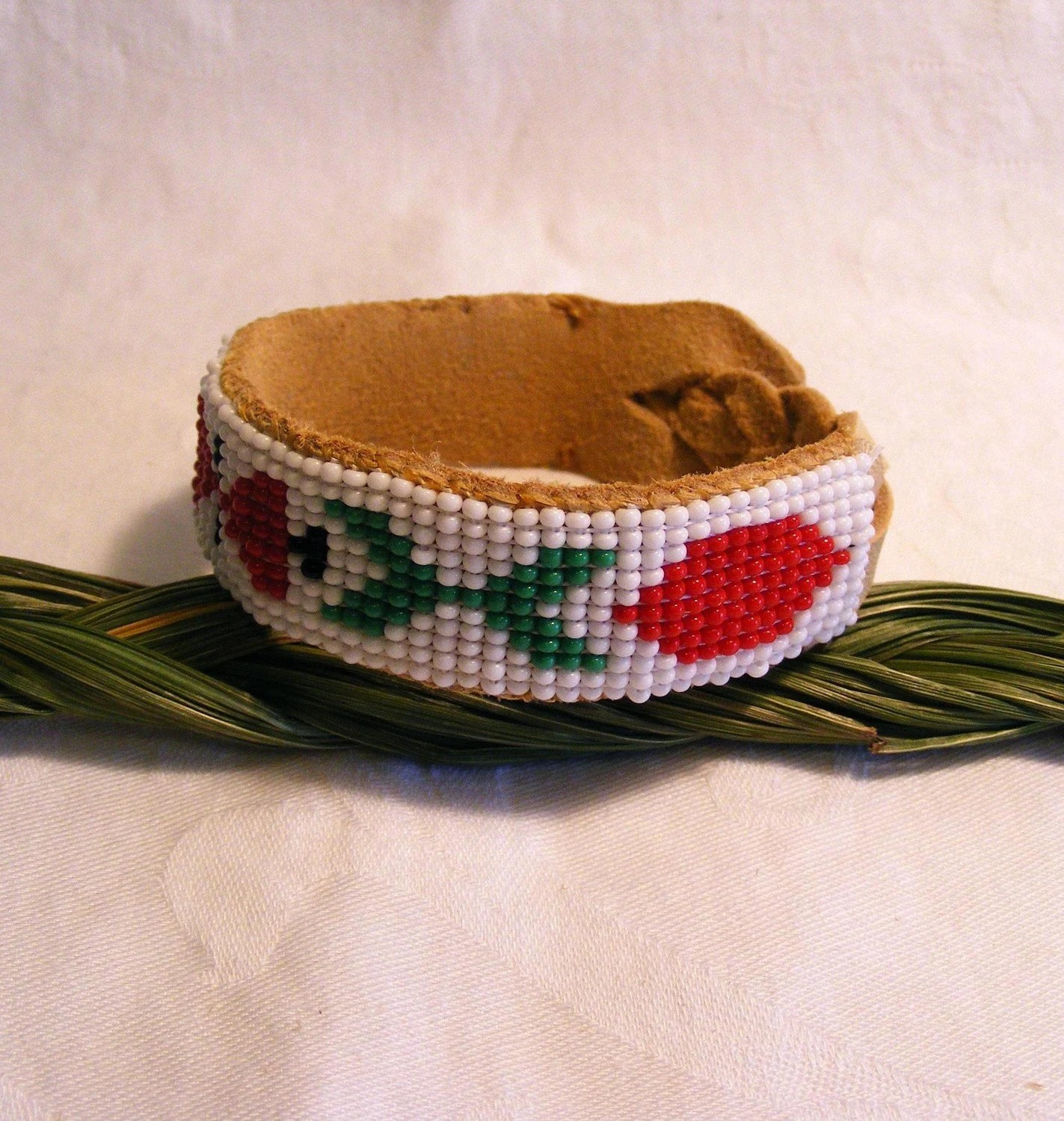 Native American style hand loomed beaded bracelet on leather