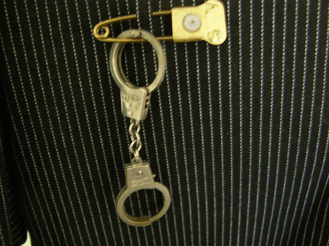 handcuff and vintage laundry pin
