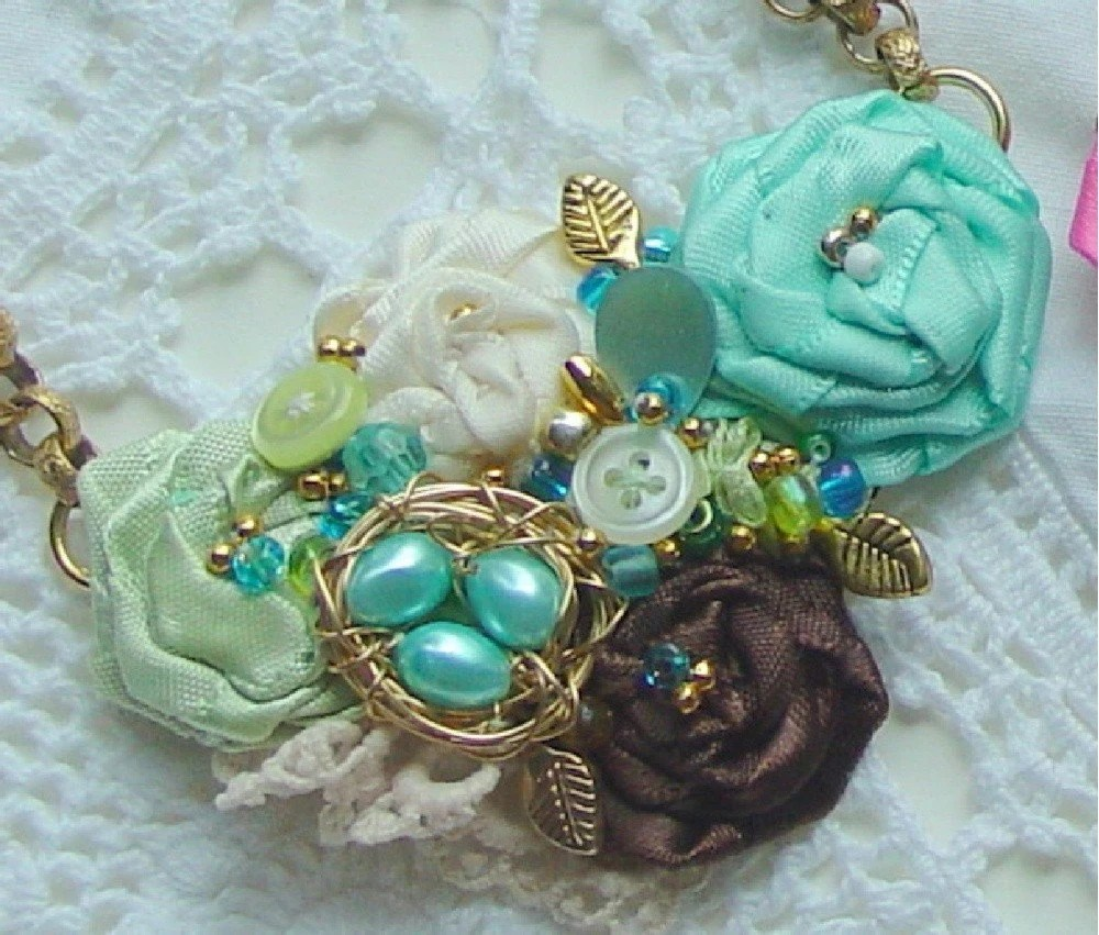 Lovely  blue and chocolate, French rosette style necklace with lace, beads, buttons and a tiny nest
