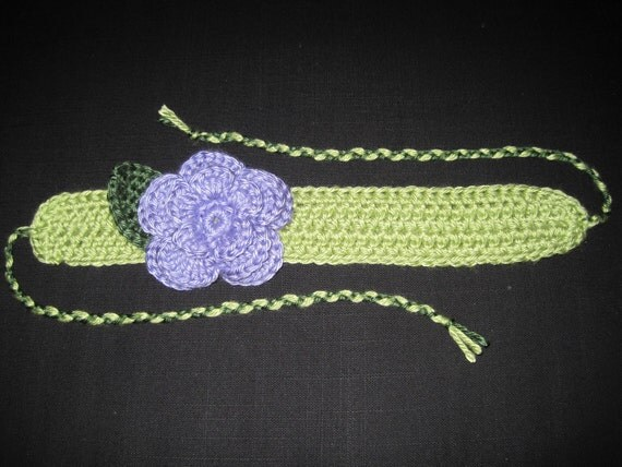 Sweet little spring head band with violet flower
