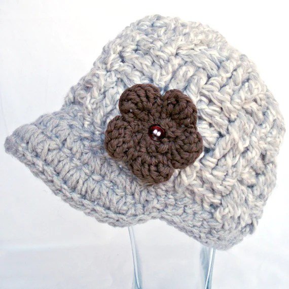 Gray/white crochet newsboy with brown crochet flower