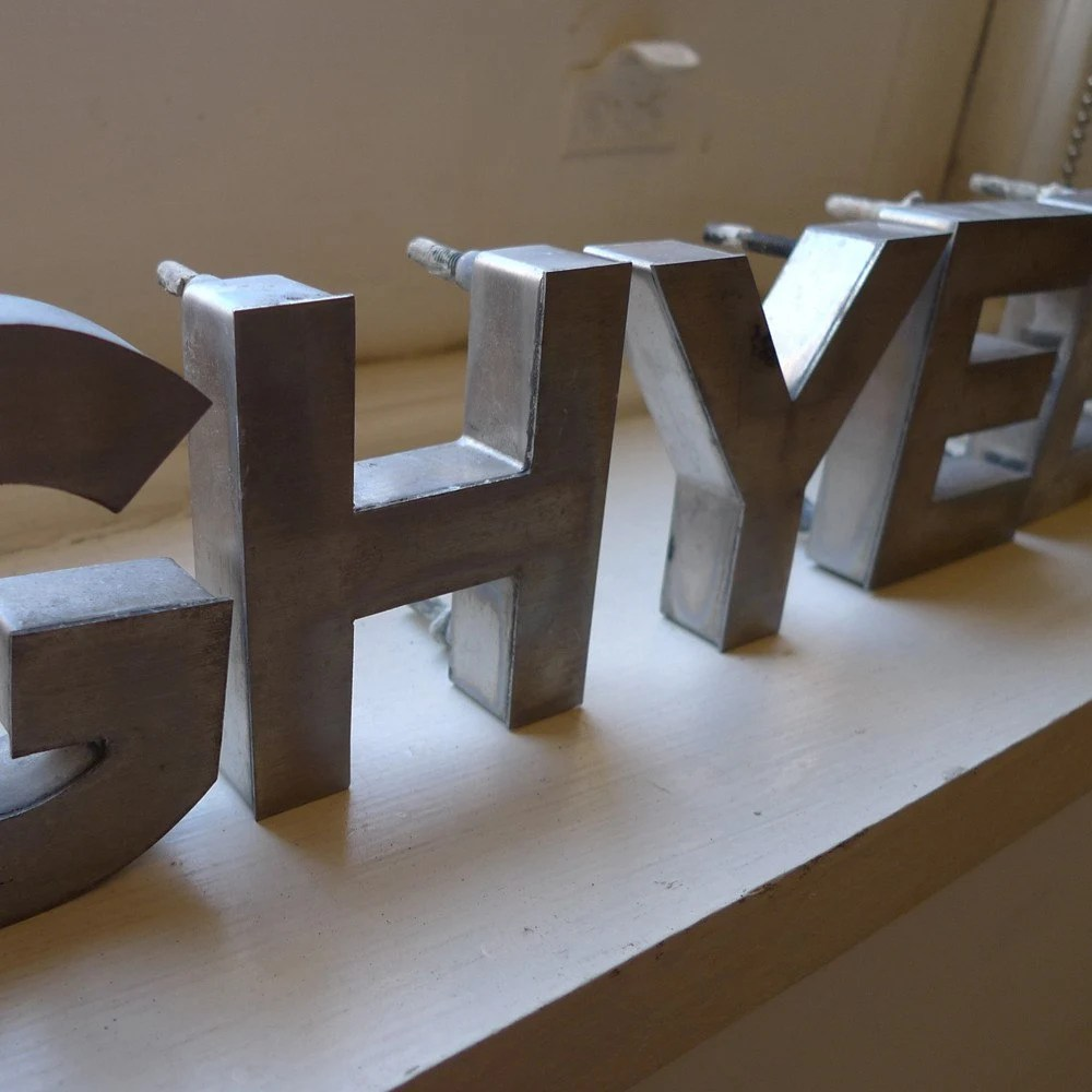 These stainless steel letterforms were rescued from a 1950s era New York parking garage that was being demolished in 2002.