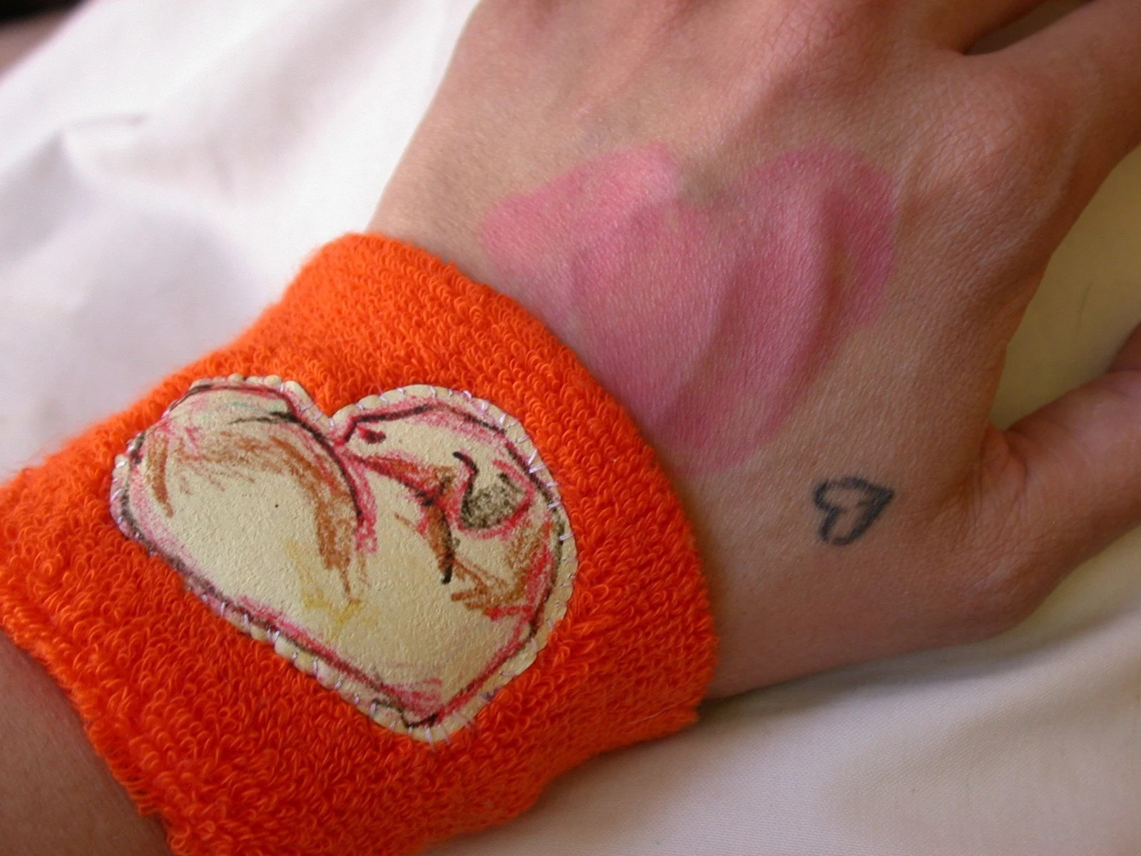 the pink on my hand is a heart my daughter drew on me.  it looks very lovely and much less skin-issue like in real life...
