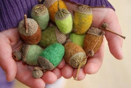 a handful of Felted Acorns