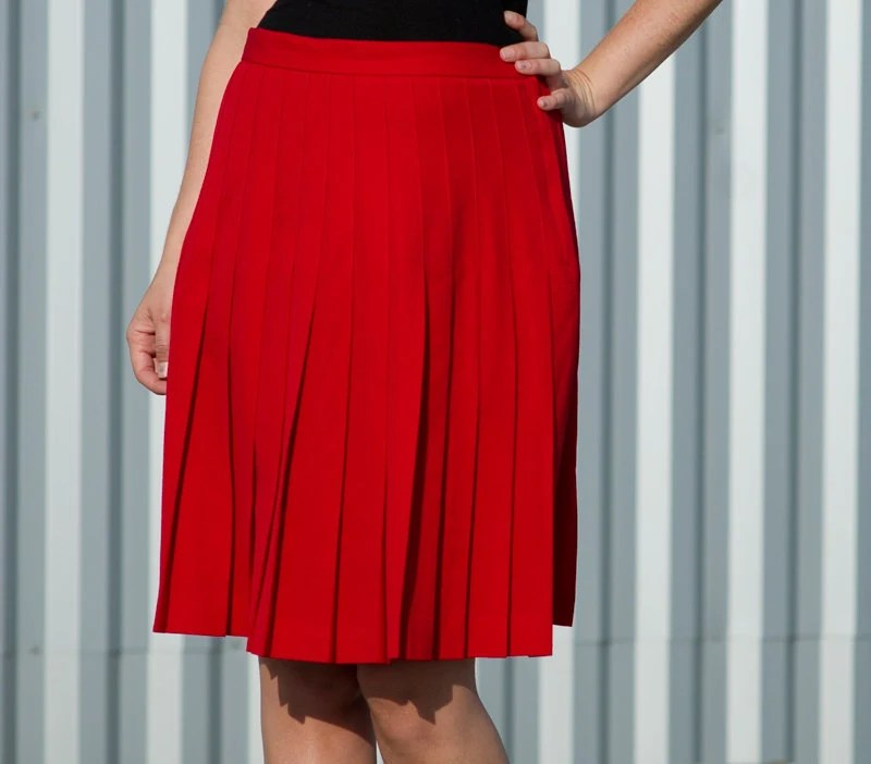red pleated mid length skirt- s m