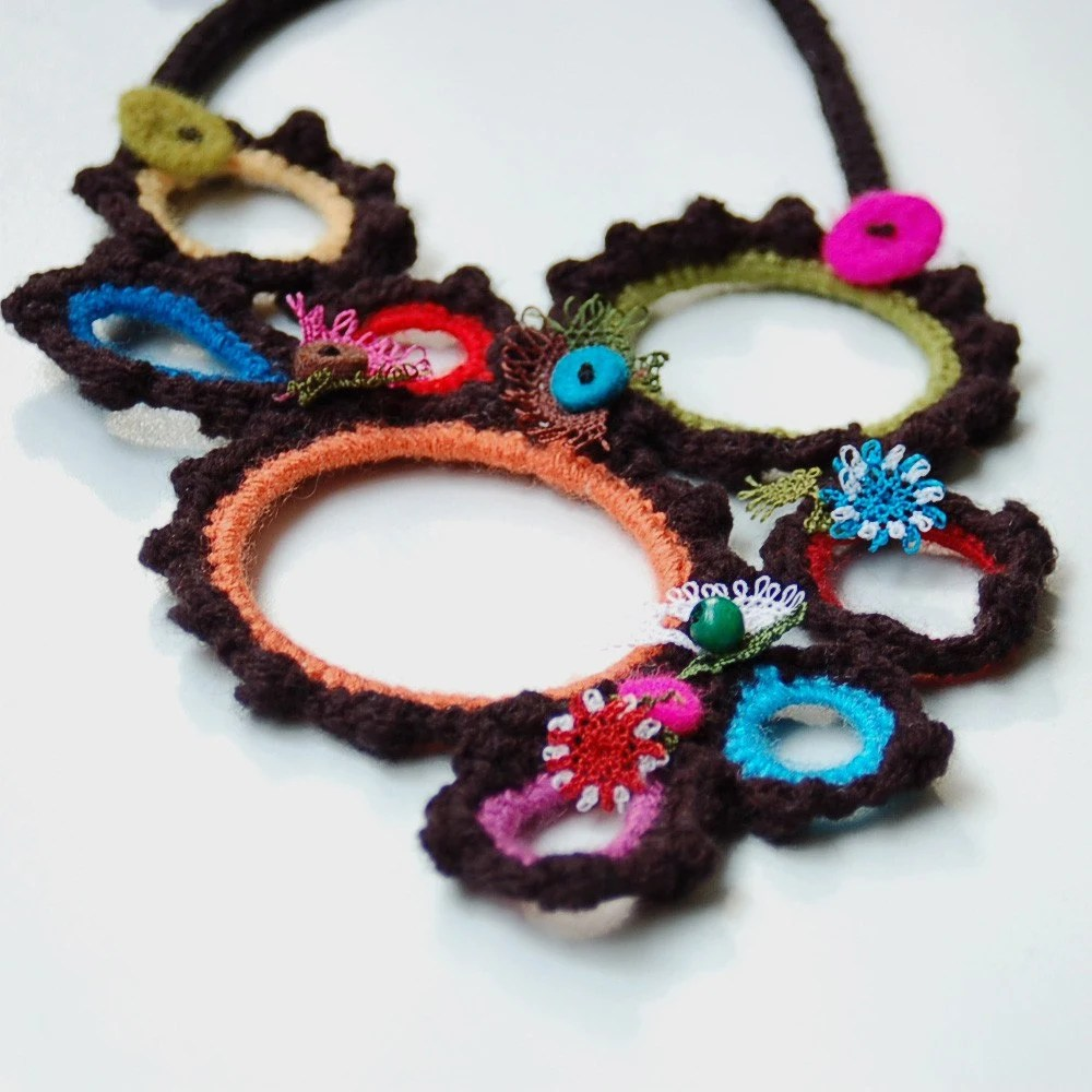 Black necklace with crocheted  colorful rings