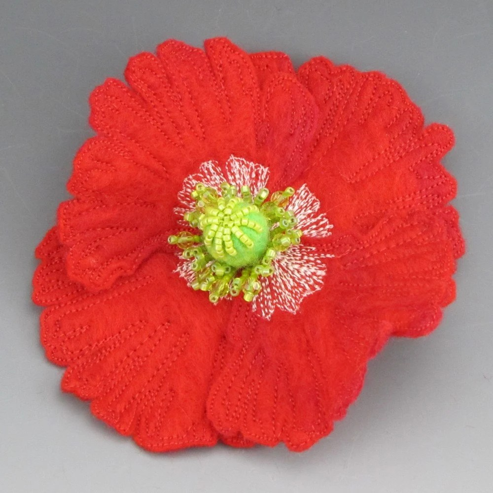 Red felt poppy brooch by cordavalera