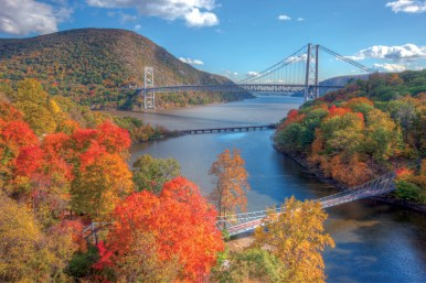 BTPNMY Autumn view of Bear Mountain Bridge with the CSX railroad bridge and the Popolopen Creek Suspension Footbridge in the foreground
