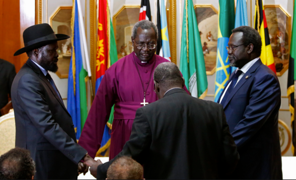 South Sudan warring leaders, Dr. Riek Machar Teny and Salva Kiir Mayardit helped to pray by the Faith Based Group during the Peace Talks in Addis Ababa. Although a peace deal was eventually signed, it has not been implemented(Photo: file)
