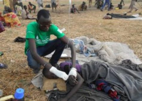 CDM team member attending to a patient in Ayod County (Photo/Rev James Tut)