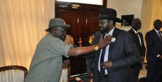 Former army chief Gen. Paul Malong Awan Greeting President Salva Kiir, the two men appear in Sentry report as