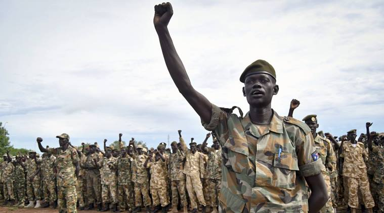 South Sudan's SPLA soldiers cheering in celebration. (Photo credit: Samir Bol)