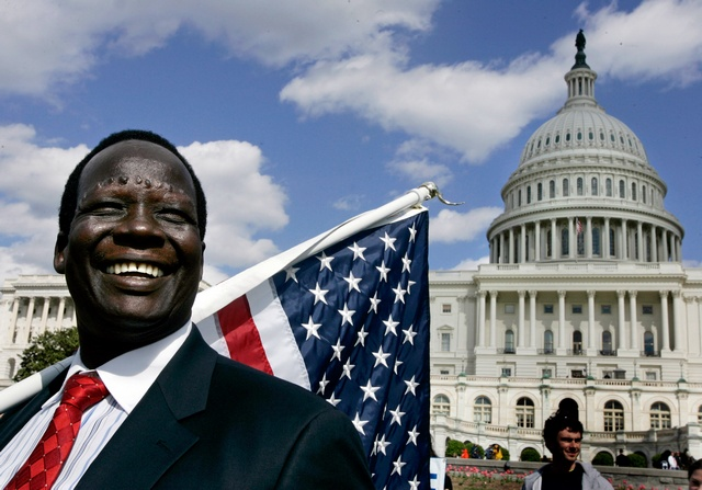 "Human rights activist, Simon Deng, is pictured after he completed his 300-mile (483 km) walk from the United Nations in New York to the Capitol Building in Washington, April 5, 2006. Deng, who was a child slave in his native Sudan, walked from New York to Washington to highlight ""the genocide and modern-day slavery in Sudan."" Congress later on Wednesday will be voting on the Darfur Peace and Accountability Act.     REUTERS/Jason Reed"