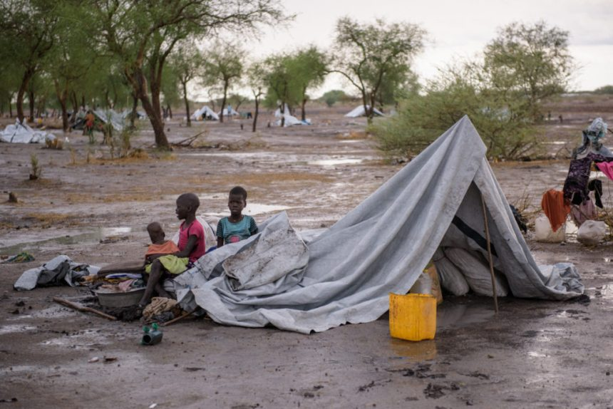 A makeshift tent is pictured following a heavy rainstorm in the village of Aburoc, South Sudan, on May 14, 2017. Some households here received tarpaulins, but many people still have only the trees for shelter as the rainy season fast approaches.(Photo credit: Aljazeera/Phil Hatcher-Moore)