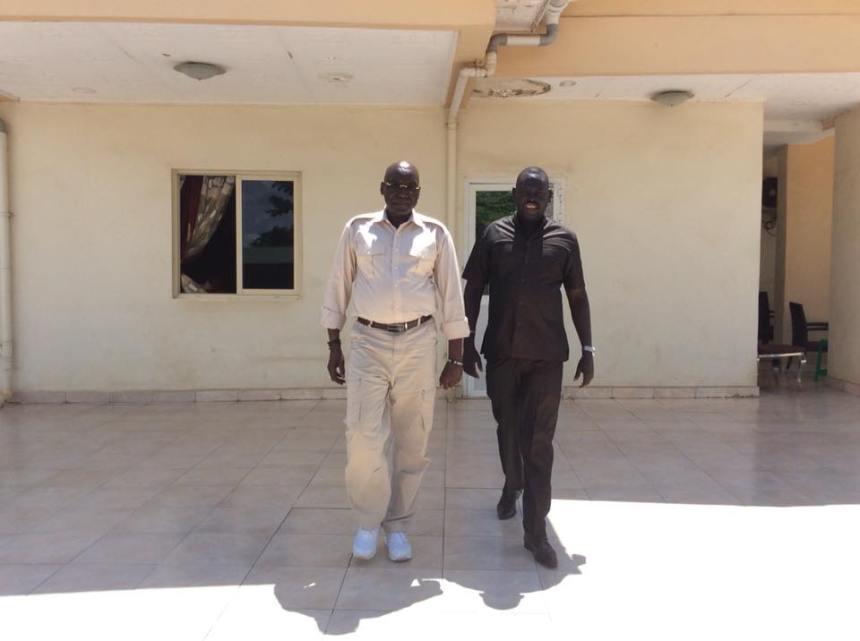 Late Bol Deng Miyen walking side by side with his hero, Gen. Paul Malong Awan, who was under house arrest in the capital, Juba(Photo: profile)