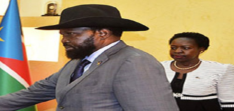 President Kiir (front) with Minister Jemma Nunu Kumba (behind) (Photo file)