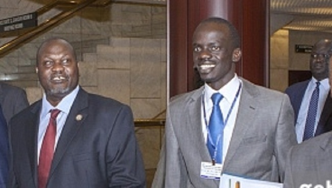 SPLM-IO Chairman Riek Machar and the the SPLM-IO Youth League Chairman Pout Kang Chuol walks prior to a meeting of the IGAD peace talks in Addis Ababa on March 3, 2015 (Photo credit: ZACHARIAS ABUBEKER/AFP/Getty Images)