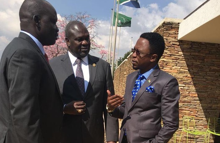 Dr. Riek Machar Teny (center) speaking to Kenya's Ababu Namwamba in South Africa on the 15th May 2017 (Photo courtesy)
