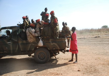 Members of SPLA seen talking to a woman in Kiir Adem(Photo credit: the Enough Project)