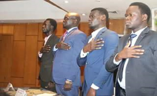 Former Chairman of Taban SPLM-IO faction Chapter in cairo Deng Machar second from the left, stands in a Press Conference as they sing the national Anthem (File photo)