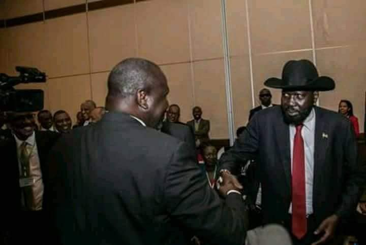 South Sudanese rival leaders, Salva Kiir and Riek Machar do a group hug with the Ethiopian Prime Minister after their first face to face meeting in Addis Ababa(Photo: file/supplied/Nyamilepedia)