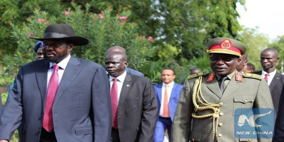 South Sudan president, Salva Kiir (L) walks with Former SPLA Chief of General Staff Paul Malong Awan (R) (File photo)
