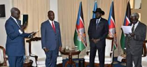 South Sudan's new foreign minister, Nhial Deng Nhial taking oath of office before Kiir and Taban Deng (Photo credit: PPU)