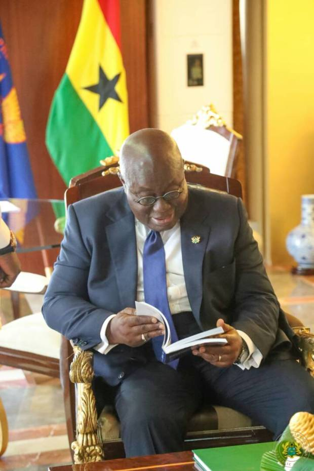 bola ray presents copy of his biography to nana akufo addo