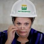 Dilma e capacete Petrobras. Imagem blog Feijoada Política.
