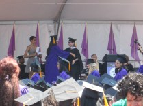 Walking across the stage, ready to hug Prof. Tag!