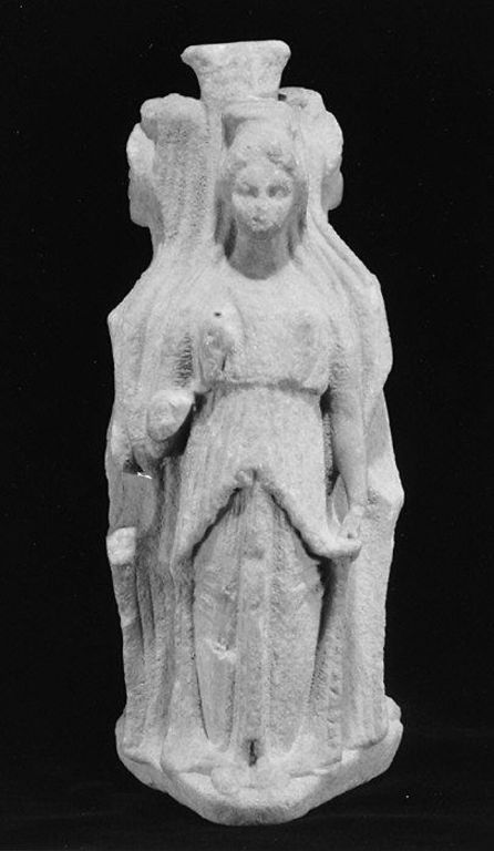 A statue of Hecate, the Goddess of Transitions and Crossroads.