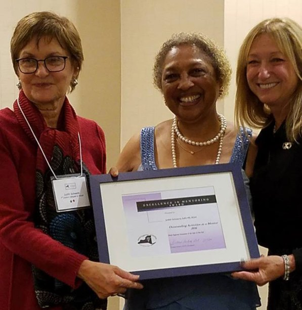 Judith Schwartz, Left, accepting Excellence in Mentoring Award from Vermell Ford, Center and Donna Hickey.