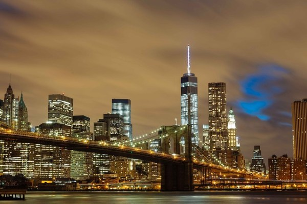People on a Brooklyn bridge are thinking about best bars in Brooklyn.