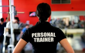 A woman wearing a personal trainer T-shirt.