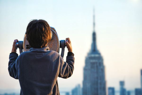 A boy observing a cityscape.