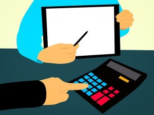A drawing of a person calculating financial budget.