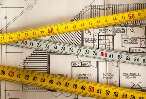 Plan of rooms with some tape measure and rulers.