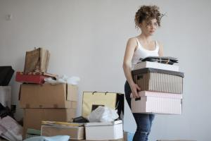 Woman thinking about common mistakes people make when moving in NYC.