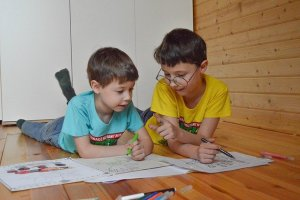 Two boys drawing.