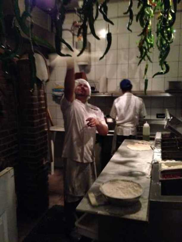 Chef Simon tossing some dough in the air!