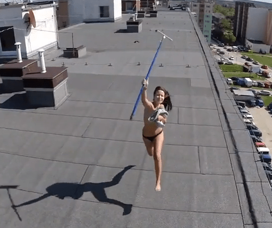 Drone trolls woman sunbathing on rooftop topless