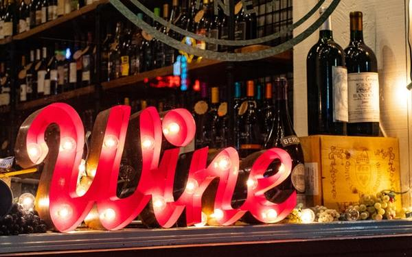 red-wine-marquee-signage-on-table-