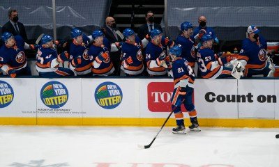 New York Islanders Center Kyle Palmieri (21) skates past the bench and is congratulated by teammates for scoring a goal during the third period of the National Hockey League game between the New Jersey Devils and the New York Islanders on May 8, 2021, at the Nassau Veterans Memorial Coliseum in Uniondale, NY.