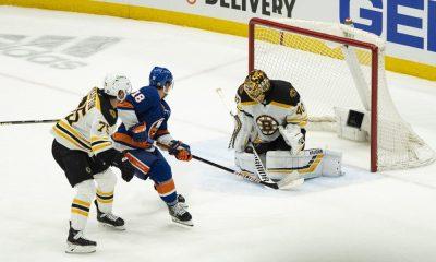 New York Islanders try to shoot on Tuukka Rask