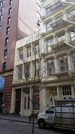 A proposed restoration of 102 Greene Street would restore the missing top two floors, but remove rent protections for artists.  Image credit: CityLand