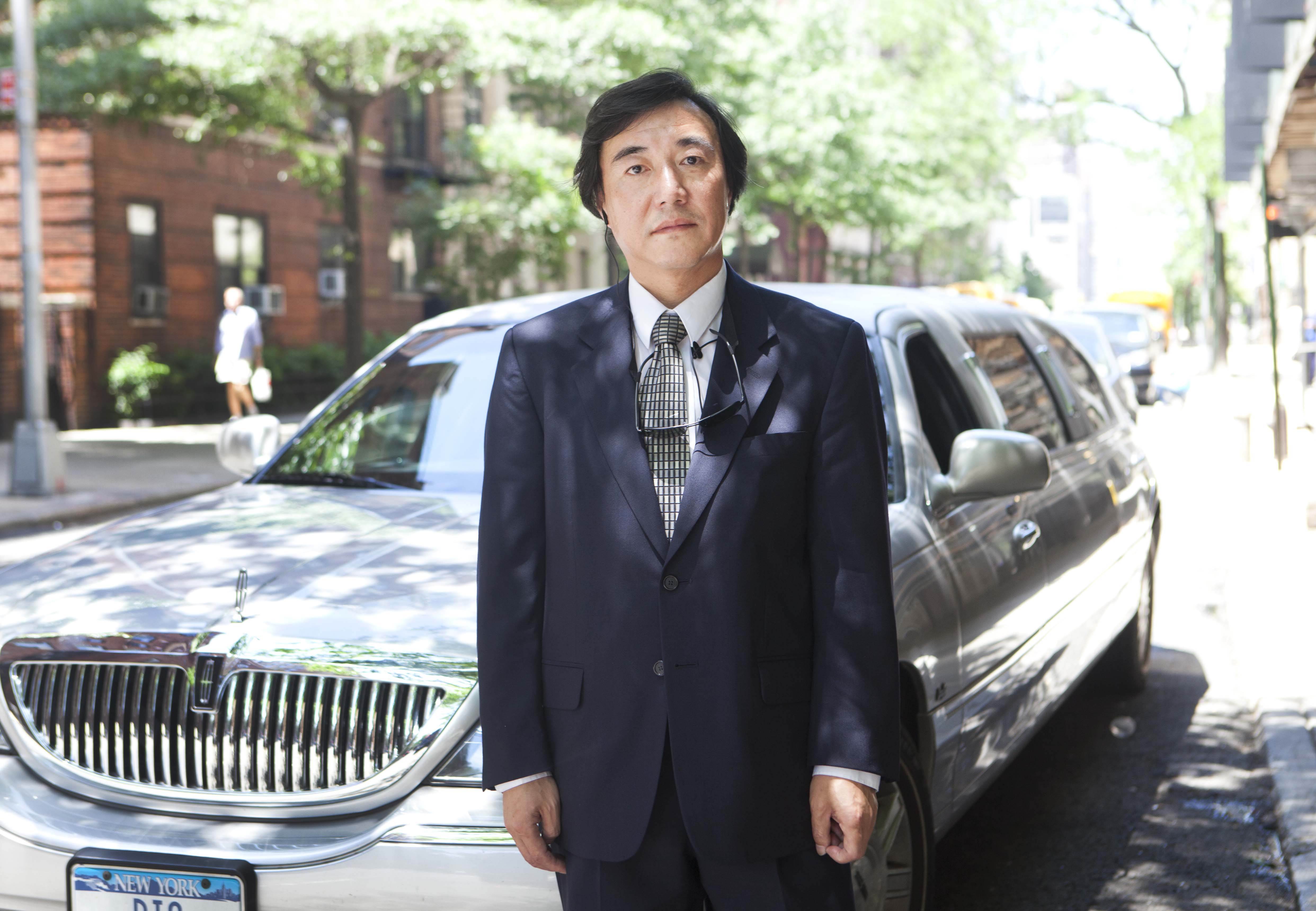 Chinese chauffeur says city racially profiled in illegal ...