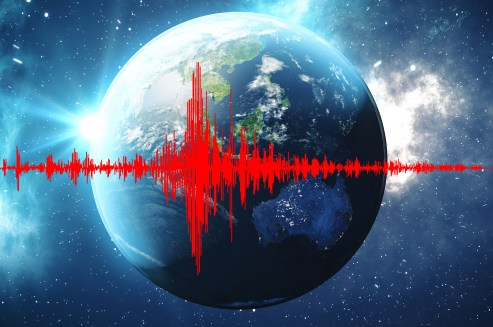 A picture of Earth with a seismograph superimposed over it